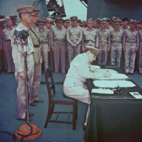 MacArthur signing Japanese surrender aboard USS Missouri, 2 Sep 1945